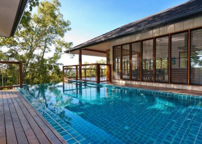 Enjoy pool views with Breezway louvres