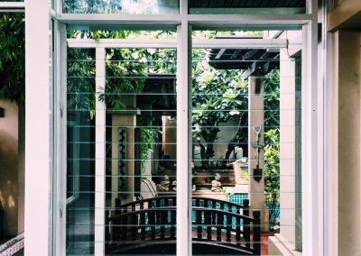 Breezway louvres with glass blades allows views to courtyard