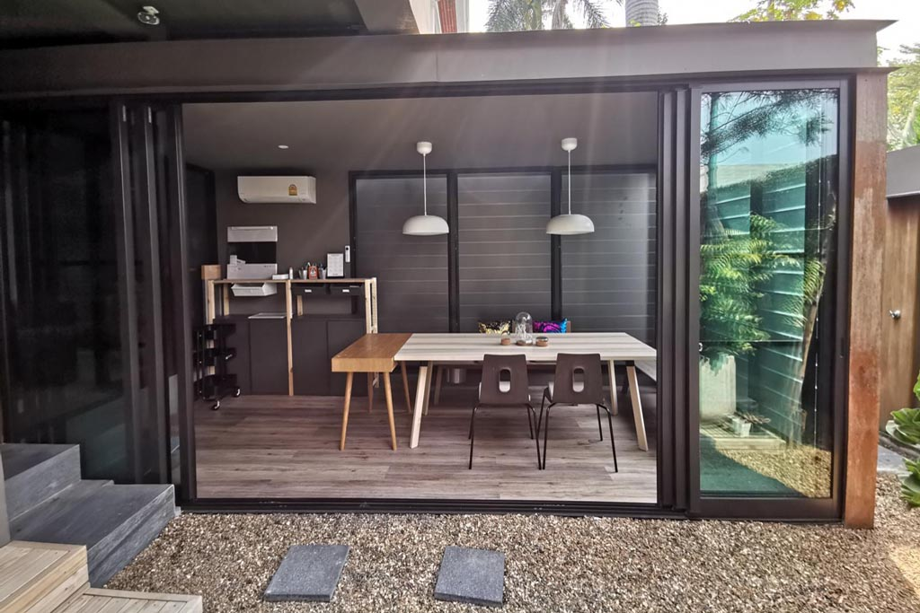 Outdoor perspective of sitting room addition with Breezway Louvres