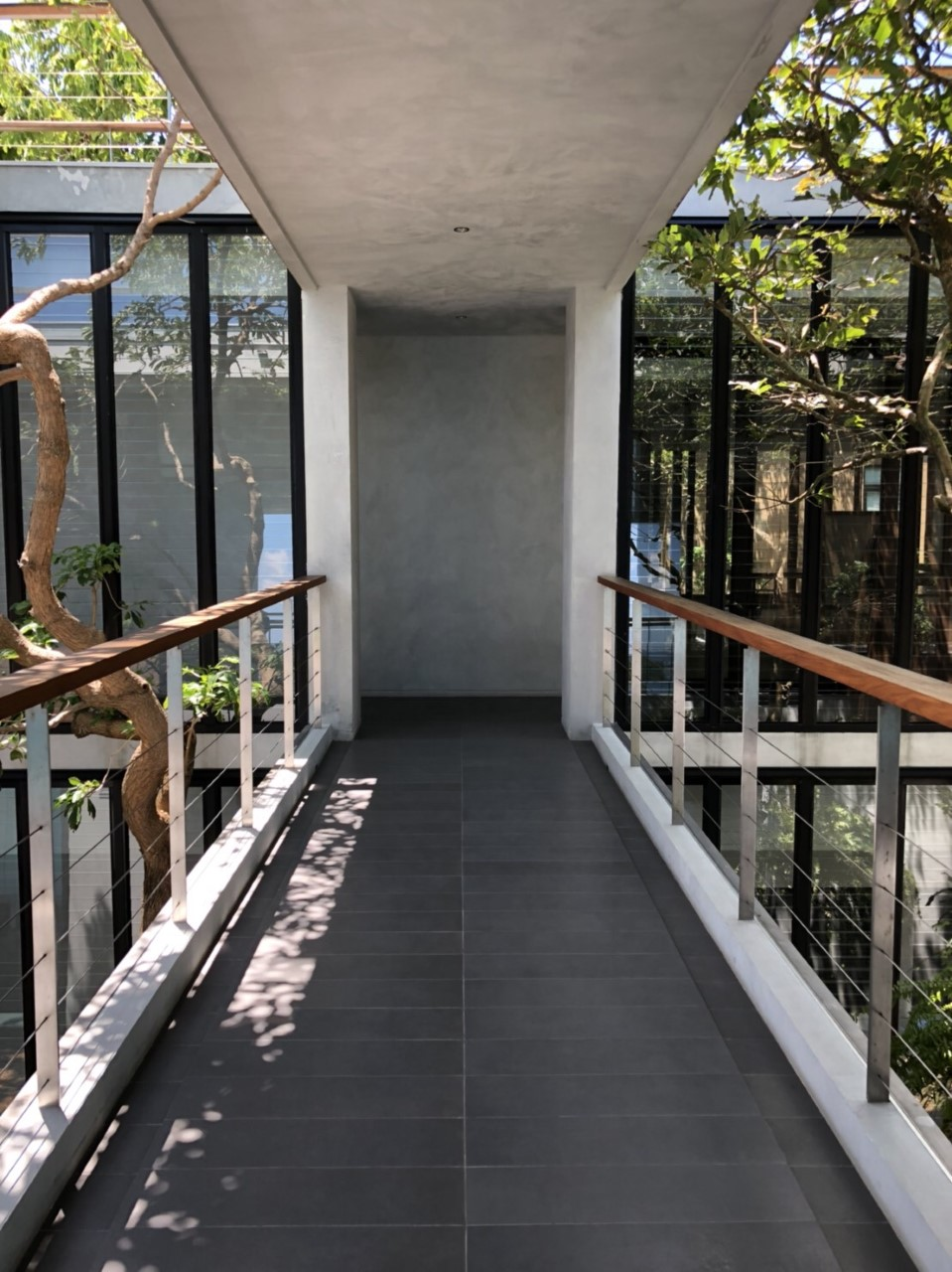 Connecting walkway between two parts of the home with Breezway Louvres either side
